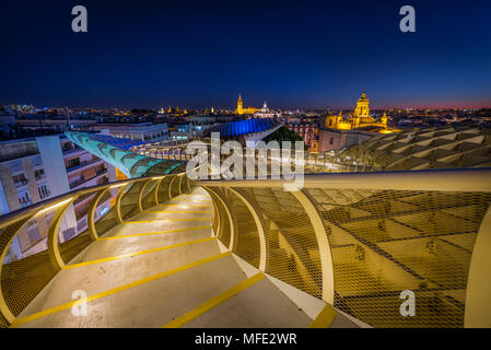 View from Metropol Parasol to numerous churches in the evening, Iglesia de la Anunciación, La Giralda and Iglesia del Salvador, - Stock Photo