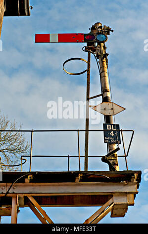 A semaphore starter stop signal in elevated position at Brundall Railway Station on the Wherry Lines in Norfolk, UK - Stock Photo