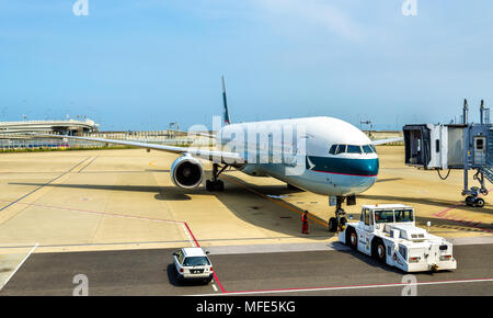Cathay Pacific aircraft in Kansai International Airport - Stock Photo