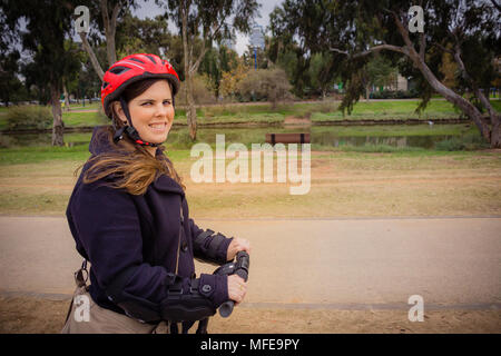 Woman riding on a Segway in the park. - Stock Photo