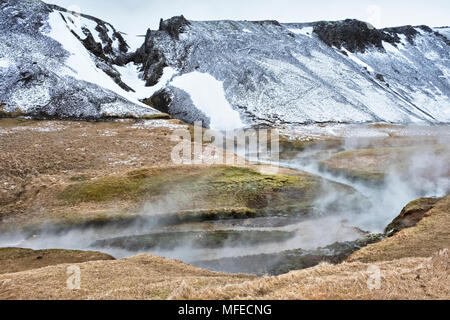 Near Hveragerði, Iceland. Steam rising from the geothermal hot river at Reykjadalur - Stock Photo