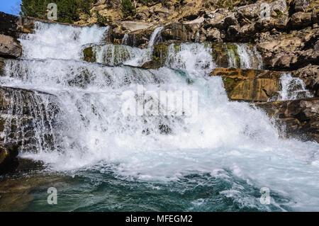Waterfall in Spring in Ordesa Valley in the Aragonese Pyrenees, Spain - Stock Photo