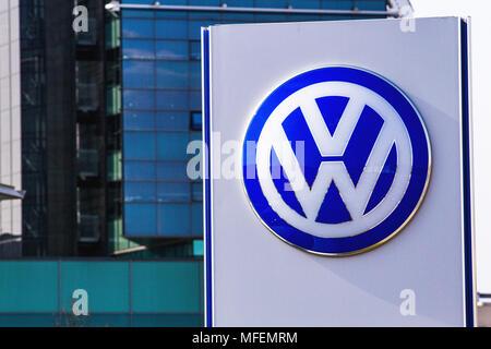 Vilnius, Lithuania- April 12, 2018: Volkswagen logo near car dealer building. Volkswagen is a German automaker headquartered in Wolfsburg. - Stock Photo
