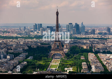 Aerial view of Eiffel Tower, Champ de Mars and La Defense district on background as seen from Montparnasse Tower in Paris, France. - Stock Photo