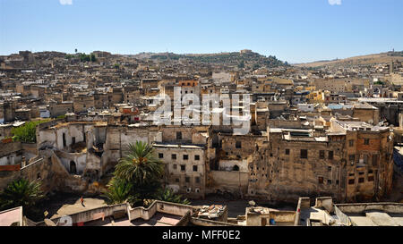 Panoramic view of the old medina of Fes, showing rooftops and old houses (Fes, Morocco) - Stock Photo