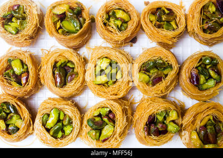 Arabic dessert with pistachio Mabroume top view pattern - Stock Photo