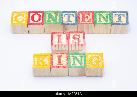 word content is king using colorful wooden block isolated on white background. - Stock Photo