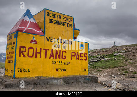 Sign at Rohtang Pass on the Manali to Leh road across the Himalayas in Himachal Pradesh, India - Stock Photo