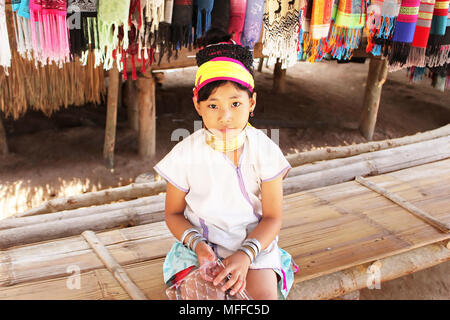 MAE HONG SON, THAILAND - JUNE 17, 2014: Unidentified Karen tribal girl near Mae Hong Son, Thailand, Chiang rai, Karen Long Neck hill tribe village - Stock Photo
