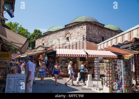 Tourists and souvenir shops in the old town, Sarajevo, Bosnia and Herzegovina - Stock Photo