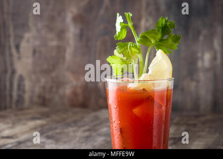 Bloody Mary cocktail in glass on wooden table.Copyspace - Stock Photo