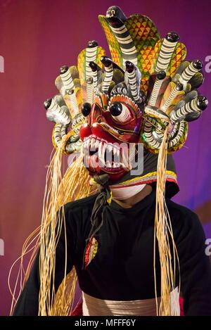 Vertical portrait of a masked Kandyan Dancer in Kandy, Sri Lanka. - Stock Photo