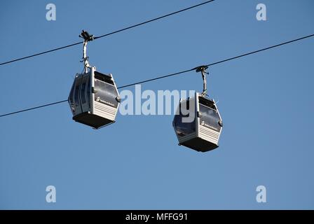 The Teleferic cable car line at Montjuic hill in Barcelona, Spain on April 19, 2018. With 55 cars, the 750 metre route opened in May 2007. - Stock Photo