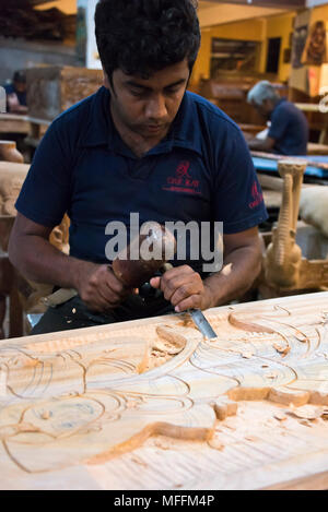 Vertical portrait of a woodcarver in Sri Lanka. - Stock Photo