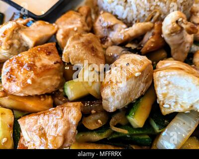 Hibachi chicken and vegetable stir fry - Stock Photo