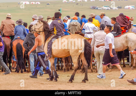 Khui Doloon Khudag, Mongolia - July 12, 2010: Horsemen at Nadaam horse race on steppe outside the capital Ulaanbaatar - Stock Photo