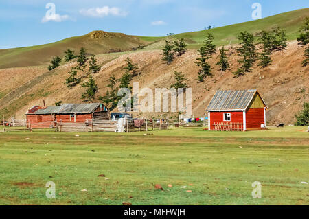 Shine-Ider District, Mongolia -  July 22, 2010: Timber houses on steppe in Khovsgol Province, northern Mongolia - Stock Photo