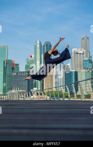 Elegant ballet dancer woman dancing ballet in the city - Stock Photo