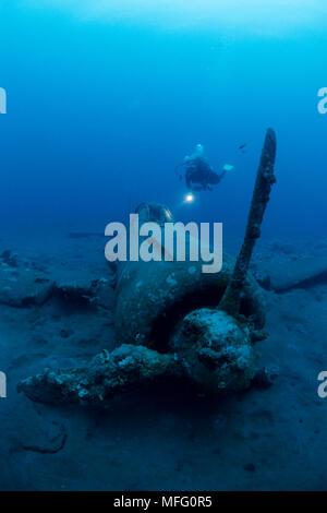 Scuba diver and wreck of airplane Zero A6M2b-Model 21, n¡8224, Gabuna Sulphur area, Walindi, Kimbe Bay, West New Britain, Papua New Guinea, Pacific Oc - Stock Photo