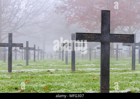 WW1 German Graves on a misty day between autumn and winter. - Stock Photo