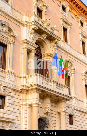 Italian and European Union flags on a balcony of the City Hall of  Perugia, Umbria, Italy - Stock Photo