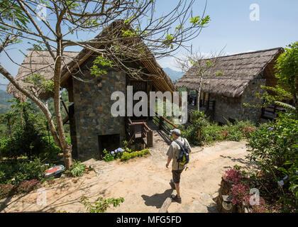 Tourist walking towards his lodge in the 98 Acres Resort & Spa, Ella, Badulla District, Uva Province, Sri Lanka, Asia. - Stock Photo