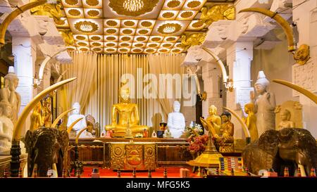 Sitting Buddha statue in Temple of the Tooth. Kandy, Sri Lanka - Stock Photo