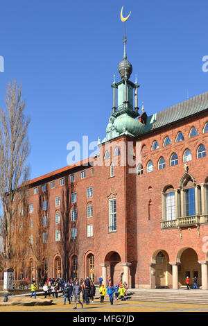 Tourists in Stockholm City Hall (Stadshuset) - Stock Photo