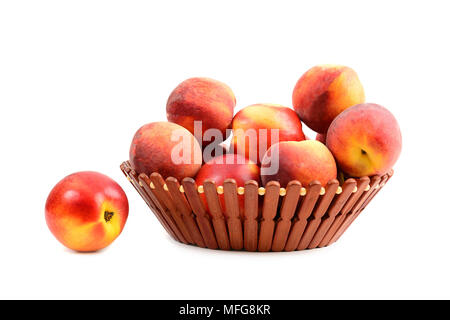 Fresh peach fruit in basket isolated on a white - Stock Photo
