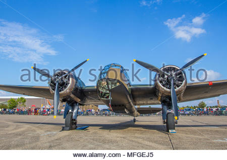 A Bristol Blenheim MkIF sits parked with engines off at Duxford Battle of Britain 75th anniversary air show on 20 September 2015 in bright sunshine - Stock Photo