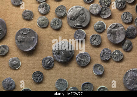 Ancient Greek silver coins (didrachm and others) from the treasure found in Cales dated from the last decade of the 4th century BC on display in the National Archaeological Museum (Museo Archeologico Nazionale di Napoli) in Naples, Campania, Italy. - Stock Photo