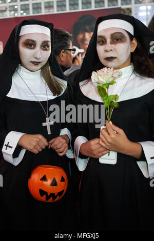 Young Japanese girls dressed as nuns at the Halloween celebrations in Shibuya, Tokyo, Japan, Asia - Stock Photo