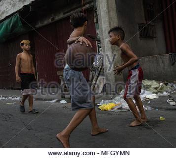 Kids playing Basketball in Manila, Philippines - Stock Photo