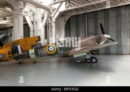 Duxford Air Museum. England, UK.  A WWII Submarine Spitfire on display in an aircraft hanger. - Stock Photo