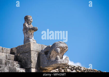 Detail of human statue and snake head at the Warriors Temple - Stock Photo