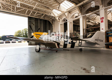 Duxford Air Museum. England, UK.  A P-51D Mustang on display in an aircraft hanger. - Stock Photo