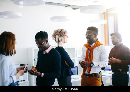 close up portrait of young multi ethnic people talking in pairs. new methods of comunication in the office - Stock Photo