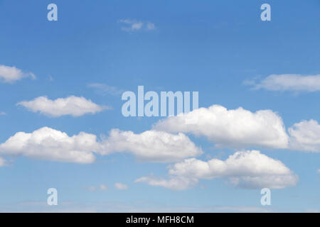 Cumulus clouds against a blue sky. - Stock Photo