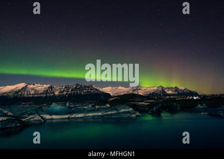 Aurora borealis over Jökulsarlon - Stock Photo