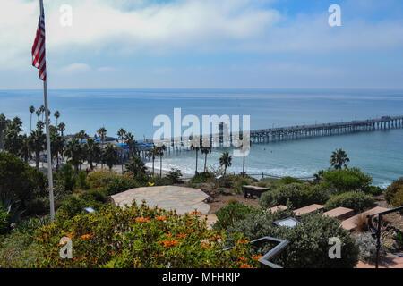 The San Clemente Pier in Southern California, Orange County as seen from Casa Romantica. - Stock Photo