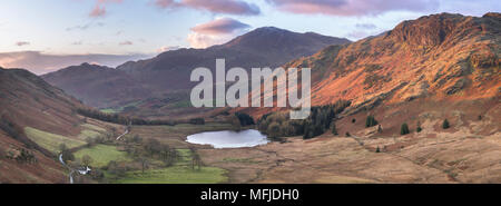 Stitched panoramic image showing sunrise at Blea Tarn in autumn, Lake District National Park, UNESCO, Cumbria, England, United Kingdom, Europe - Stock Photo