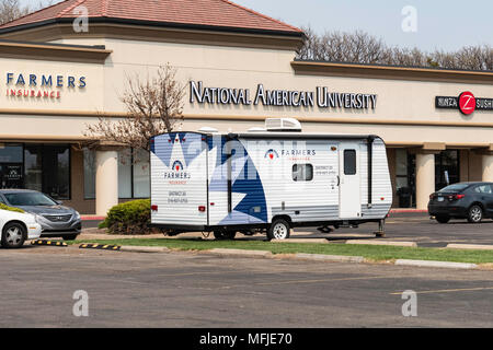 Farmers Insurance Casualty trailer parked outside the business. Wichita, Kansas, USA.. - Stock Photo