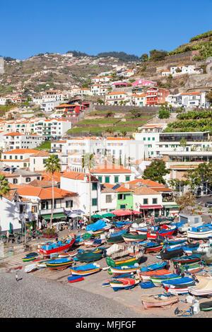 Traditional colourful fishing boats on the beach in Camara de Lobos fishing village, Madeira, Portugal, Atlantic, Europe - Stock Photo
