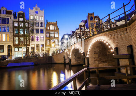 View of tall 18th century buildings on a canal in Amsterdam, Holland, Netherlands, Europe - Stock Photo