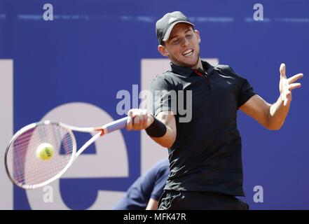 Barcelona, Spain. 26th Apr, 2018. Austrian tennis player Dominic Thiem returns the ball to Slovak Jozef Kovalik during their round of 16 match at Barcelona Open Trofeo Conde de Godo in Barcelona, northeastern Spain, 26 April 2018. EFE/Andreu Dalmau Credit: EFE News Agency/Alamy Live News - Stock Photo