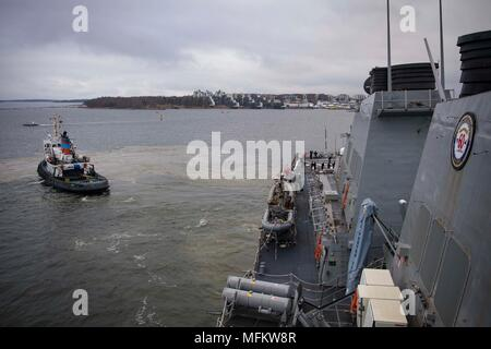 180422-N-JI086-037 HELSINKI, Finland (April 22, 2018) A Finnish tugboat guides the Arleigh Burke-class guided-missile destroyer USS Porter (DDG 78) as the ship departs Helsinki, Finland, April 22, 2018. Porter, forward-deployed to Rota, Spain, is on its fifth patrol in the U.S. 6th Fleet area of operations in support of U.S. national security interests in Europe. (U.S. Navy photo by Mass Communication Specialist 3rd Class Ford Williams/Released) - Stock Photo