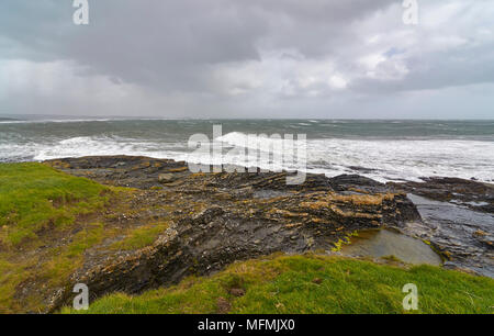 A large Atlantic Storm moves over Slade and County Wexford, with High Winds and a large Running Swell coming in from the West. - Stock Photo