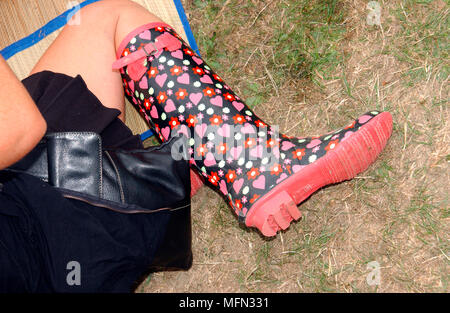 Low section view of a woman wearing a designer wellington boot   Ref: CRB360_10028_009  Compulsory Credit: Peter Johnson / Photoshot - Stock Photo