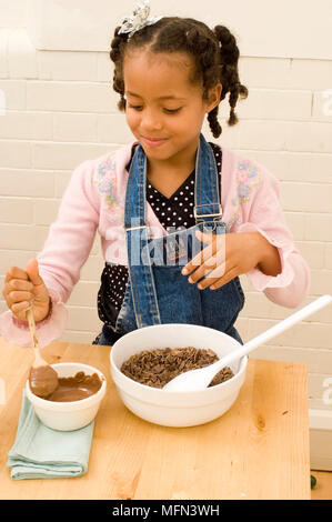 Close-up of a girl preparing a chocolate dish   Ref:   Compulsory Credit: - Stock Photo