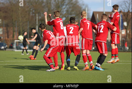 Football-players forming a wall - Stock Photo